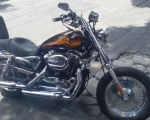 motocicleta con flamas harley davidson en renta